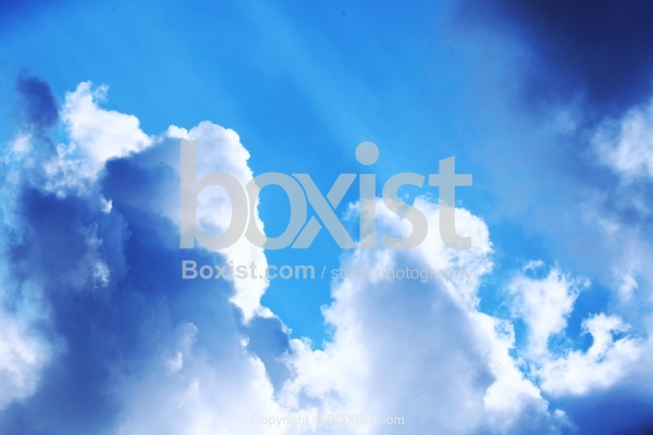 Shiny Blue Sky With White Clouds
