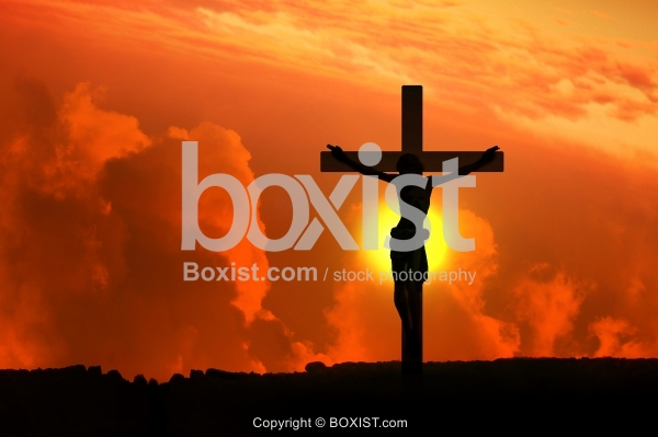 Concept of Jesus Silhouette Hanged On The Cross At Sunset