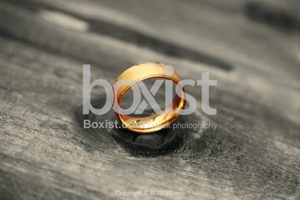 Golden Round Ring On Wood