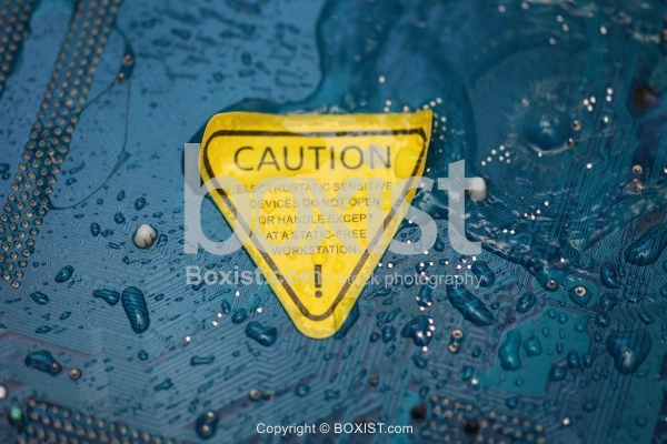 Electronic Circuit Board With Caution Sticker.