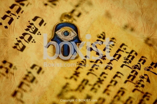 Closeup Of Hamsa Hand On Top Of Jewish Hebrew Torah Page