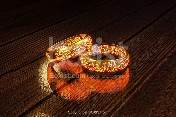 Two Golden Rings With Arabic Calligraphy