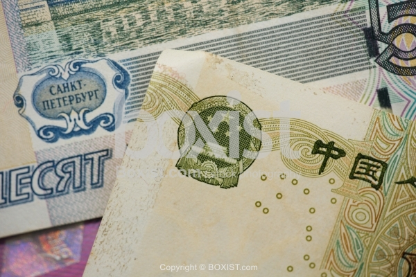 Closeup Of Russian And Chinese Money