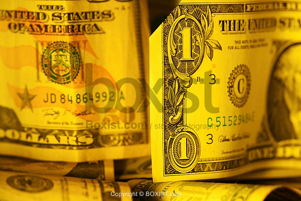 Notes Of American Dollars Under Yellow Lights