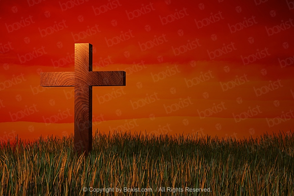 Wooden Cross In Grass At Sunset