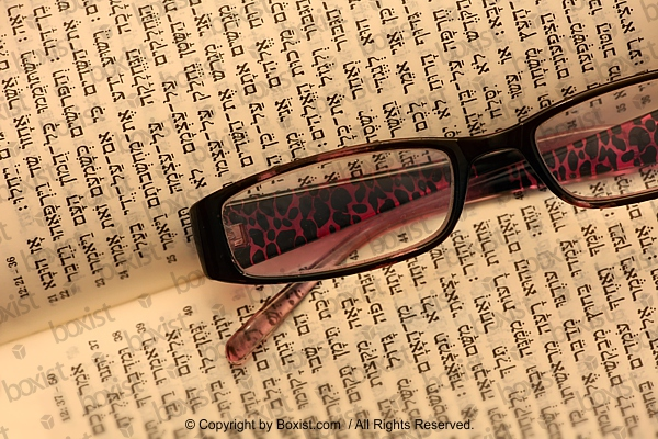 Glasses In The Middle Of Torah Book