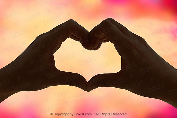 Silhouette Of Love Heart Symbol Formed With Two Hands