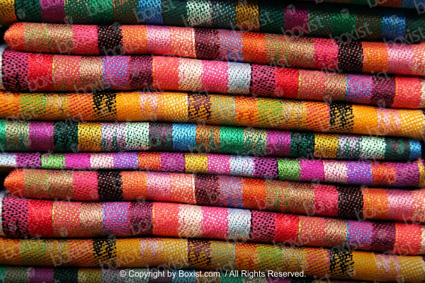 Stack of Folded Colored Rugs