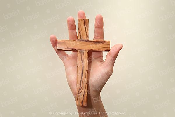 Hand Holding Wooden Cross