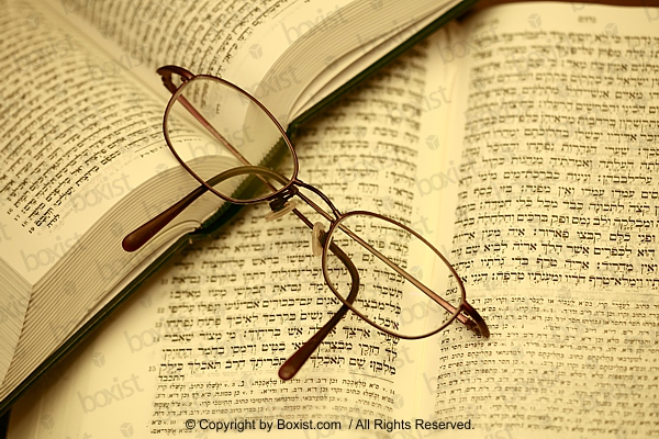Reading Glass Lying On Jewish Books