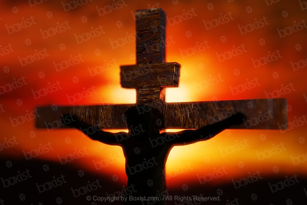Closeup Of Jesus Hanged On The Cross At Sunset