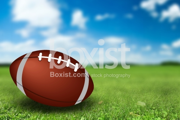 American Football on Green Field