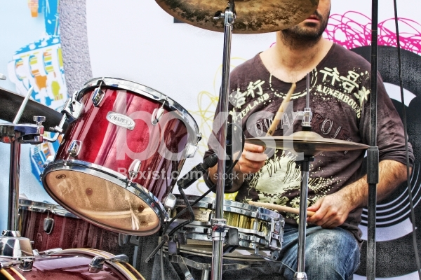 Musician Working on Drums
