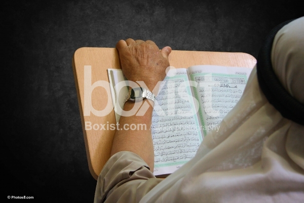 Muslim Man Reading Quran Book