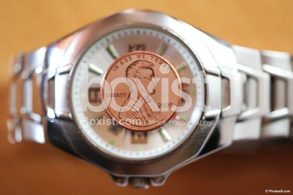 One Cent Coin Over Hand Watch