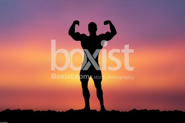 Bodybuilder Poses at Sunset