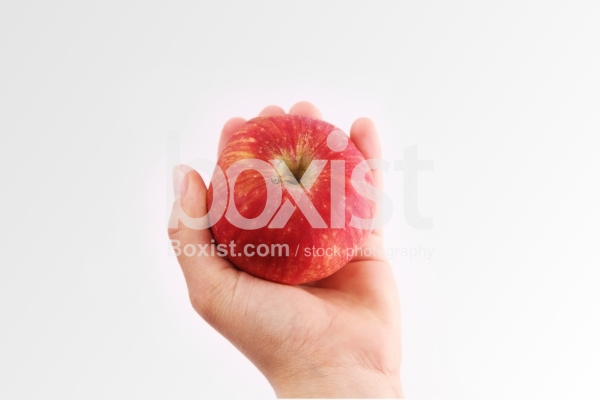Holding Red Apple in One Hand