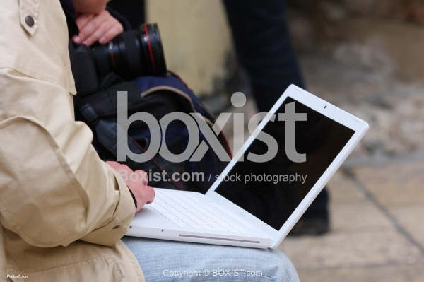 Using Laptop on Street