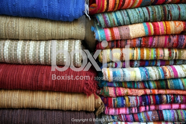 Stack of Colored Fabrics and Rugs