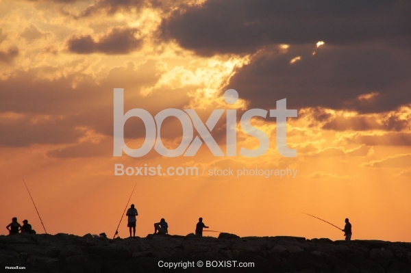 Group of Fishermen Fishing at Sunset